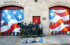 painted on the garage doors of the Rescue 5 firehouse in Concord, features a waving flag, one with 11 stars visible, and silhouettes of the Twin Towers. Most importantly, though, painted along the bottom of the doors are 11 pairs of empty boots.