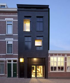 Black Pearl by Studio Rolf.fr in collaboration with Zecc Architecten, Rotterdam. This revitalised Rotterdam townhouse was formerly an abandoned apartment block.