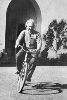 Albert Einstein on bycicle