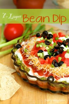 7-Layer Bean Dip - uses fresh vegetables and your favorite salsa, delivering seven layers of deliciousness on a single tortilla chip. | freshlyphotographed.com