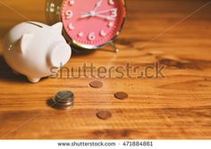 piggy bank with money on wood background. Concept save money.selective focus