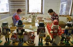 Craftsman in Seiffen, Germany busy making Christmas nutcrackers.  Pinned by www.mygrowingtraditions.com