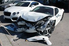 Watching a luxury car in tormented condition, is a hard sight for car enthusiasts. Recently, we found a white colored wrecked up Ferrari 458 Spider with severe frontal damage. Presumably, it would have hit another car straight, and is now waiting to be repaired in an open lot at RDB LA Collision center.