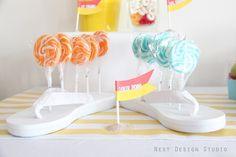 Flip Flops used as a lollipop holder:) How cute!