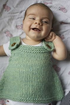 http://www.ravelry.com/patterns/library/baby-frock  Hannah Fettig strikes again!
