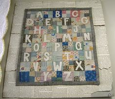 Dolly alphabet quilt, maybe 16x14, letters appliquéd on pieced background...