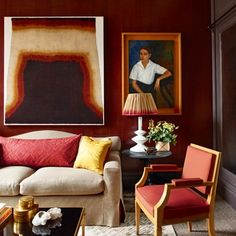 In the study of Douglas Mackie's Marylebone flat, there is plenty of inspiration for a living room. Oxblood red walls provide a dramatic backdrop for a portrait by Spanish-Cuban artist José Segura Ezquerro and a lampshade made from an antique sari. Red Walls, Decor, Red Living, Furniture, Interior, Central London Apartments, Home Decor, House Interior, Room