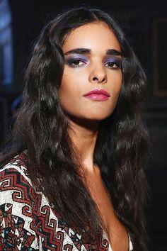 Fuzzy hair, raspberry lips, and purple eyeshadow