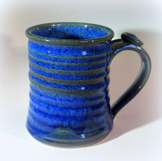 Large Pottery Coffee Cup, Handmade Ceramic Mug with Thumb Rest, Lapis Blue. $19.00, via Etsy.