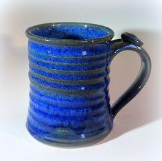 Large Pottery Coffee Cup, Handmade Ceramic Mug with Thumb Rest, Lapis Blue. $19.00, via Etsy.