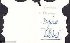 Nineteen Christmas gift tags signed by the Queen, including this one signed using her pet name to David Armstrong-Jones, Viscount Linley,  have been put up for auction by a relative of a former royal bodyguard