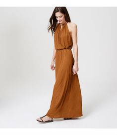 "Make vacation style a glam affair in this floor-sweeping maxi dress, punctuated with an alluring keyhole neckline. Halter neck ties at back. Shirred neckline with keyhole cutouts. Draped wrap-effect front. Shirred elasticized waist. 41 1/2"" from natural waist.</p> <p> <br /> <br /> <em><span style=""color: purple;"">Items in our Swim Collection can only be exchanged or returned by mail. <br /></span></em></p>"