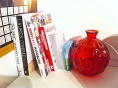 Coffee table books and red john lewis vase