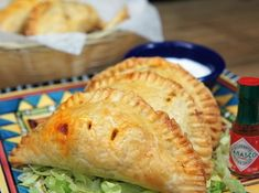 These hot and flaky, hand pies are filled with a delicious and flavorful taco filling. We use ground turkey that's seasoned with a southwestern-inspired seasoning blend, black beans, corn and just a little bit of Monterey Jack cheese and green onions.