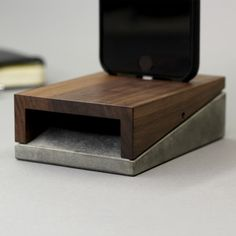 The Mobi combines the roughness of concrete and the elegance of wood. The result is a, sleek, adaptable charging station, concealed in a minimalistic clean-lined object. Smartly equipped with a micro-suction pad free of adhesives, it can be affixe. Iphone 8 Plus, Iphone 6, Wooden Speakers, Passive Speaker, Smartphone, Iphone Holder, Gadgets, Concrete Wood, Phone Stand