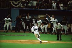 Griffey rounds third and heads for home as the entire Mariner and fans sense victory.