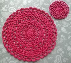Circular pink lacy crochet doily - in several colors, this would make a pretty mandala!