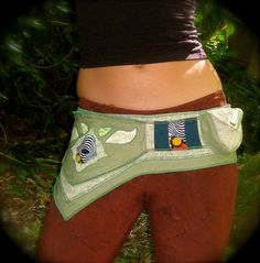 I really want to make one of these upcycled utility belts for festivals out of pockets and things.