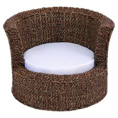 Woven rattan pet bed with a cushion.  Product: Pet bedConstruction Material: Natural rattan and fabric