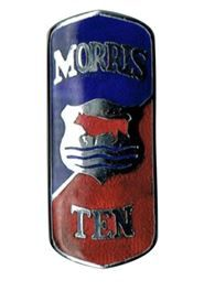 This post war 10 Series M badge is more colourful than the earlier Morris 10 Series II and Series M shield shaped badges and was designed to follow the chrome grille and bonnet strip. Marked J Fray, B'Ham. This badge looks to be unused,
