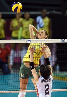 Thaisa Menezes of Brazil spikes the ball