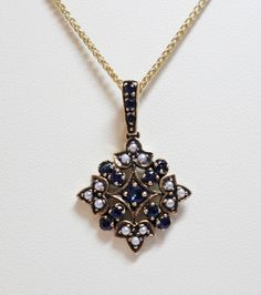 9ct Yellow Gold Blue Sapphire and Cultured Freshwater Seed Pearl Flower Cluster Pendant £235.00 Vintage Antique Reproduction Jewellery Contact us at www.facebook.com/ellisondaviesjewellery for more information
