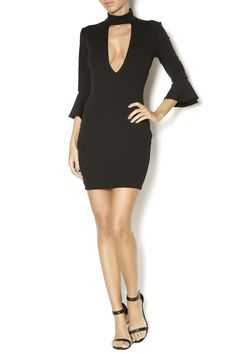 3/4 sleeve dress with turtle-mock neck and keyhole neckline. Wear to your next late night date and style with pumps