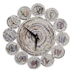 Coiled newspaper (or magazine) clock made by women in the Philippines.  11""