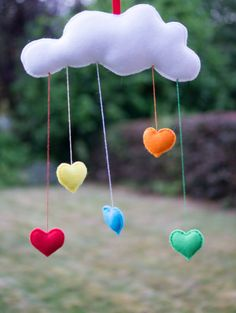 Cute felt cloud mobile wall hanging with rainbow by Sewkidding, £12.00