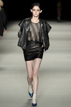 Leather cape jacket draped over sheer top