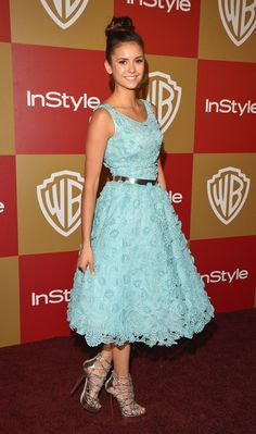 Floral appliqués are such a lovely way to add texture and charm to a garden wedding. For inspiration, check out the soft turquoise Oscar de la Renta dress that Nina Dobrev donned at the InStyle and Warner Bros. Golden Globe after-party. Her silver add-ons lent just enough shine.