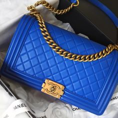 """70053bea34a9 Opulent Habits on Instagram: """"WOW! 😍💎💙Calling all BLUE lovers! Authentic  Chanel Blue Lambskin New Medium Boy with antique gold hardware!"""