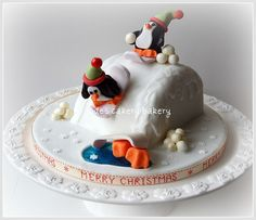 Penguin Snowboarding Christmas Cake Oops One fell into the icy Pond by www.judescakerybakery.co.uk, via Flickr