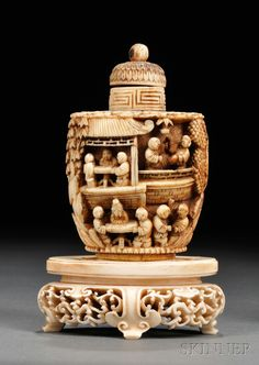 Ivory Snuff Bottle with Ivory Stand, China, baluster form, carved in relief with a continuous scene depicting figures engaging in various leisurely activities in a garden with pavilions and trees, the flat shoulders decorated with clouds, overall ht. 4 1/4 in.