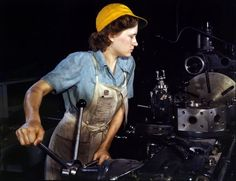 October 1942. Lathe operator machining parts for transport planes at the Consolidated Aircraft plant in Fort Worth, Texas.