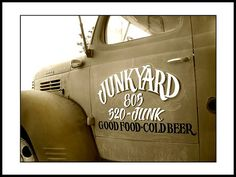 JunkYard Cafe Dodge Truck. Advertising Good Food and Cold Beer in Simi Valley, California. They use garage rags for napkins and none of their silverware or coffee mugs match...a cool and quirky place!