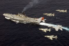 Two US F/A-18E/F Navy Super Hornets fly in formation with two Indian Navy Sea Harriers, and two Indian Air Force Jaguars, over Indian Navy aircraft carrier INS Viraat on Sept. 7, 2007. US Navy Photo