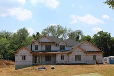 New home construction in Evansville with a Chapman Roof installed with GAF shingles.
