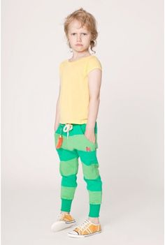 The look on this kid's face just kills me. Plus, it is fun to have brightly coloured clothes to wear when you are small.