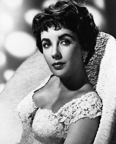 ca. 1950s --- Actress Elizabeth Taylor is shown seated in a chair in this head and shoulders portrait. Ca. 1940s-1950s. --- Image by © Underwood & Underwood/CORBIS