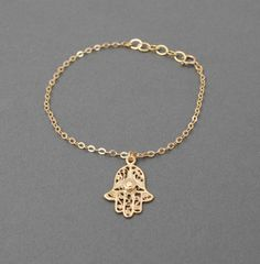 Gold Hamsa Hand Bracelet also available in sterling silver.. $22.00, via Etsy.