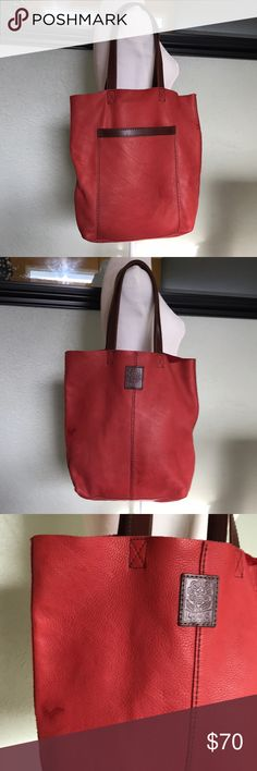 Lucky Brand pebbled leather open tote Gorgeous shoulder bag by Lucky Brand. Red pebbled leather with brown leather straps. Two spots as pictured on bag. Raw interior. Large front pocket. Excellent for carrying extra items. Great condition minus cosmetic flaws! Approximate measurements height 14.5, width along top 15.5, depth 2.5, handle drop 9 1/4. Lucky Brand Bags