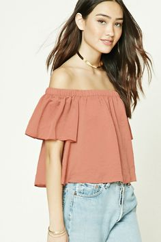 A satin top featuring an off-the-shoulder design, elasticized neckline, short sleeves, and a boxy silhouette.