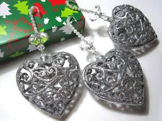 These pretty sparkly hearts have a filigree style design covered in glitter, and are so pretty on the Christmas Tree as they let the light