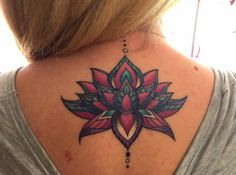 Beautiful lotus tattoo . Color life. Love the placement .