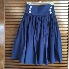 Blue Teacup Skirt Skirt is flowy while the thick band accentuates the smallest part of your waist. White and blue pinstrip buttons add the right amount of detail. Zipper located on the side. Pair it with girly heels or the perfect sandal! Skirts Circle & Skater