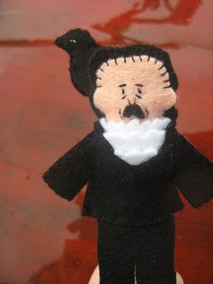 I don't know why, I think this is a hoot -  edgar allan poe finger puppet