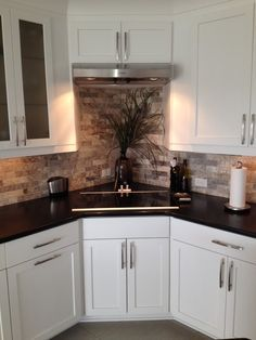cabinets. Corner stove. Could be good use of space for some kitchens