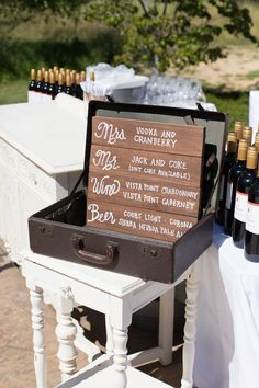 drink menu in vintage suitcase http://www.weddingchicks.com/2013/10/03/vintage-outdoor-wedding/
