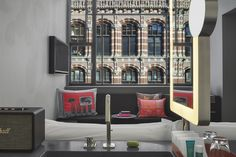 Located in the epicenter of Amsterdam's vibrant social scene, the former Telephone Exchange building features 172 stylish guest rooms, all with IVANKA concrete multifunctional vanity-shower-desk units.